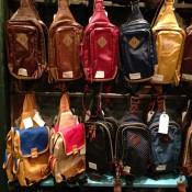 Backpack wall at Wego Harajuku in Tokyo. Photo by alphacityguides.