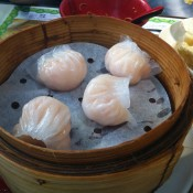 Steamed shrimp dumplings at Tim Ho Wan in Hong Kong. Photo by alphacityguides.