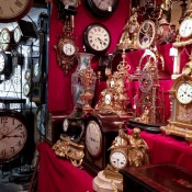 Vintage clock display at the Portobello Market in London. Photo by alphacityguides.
