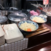 Udon with raw egg at Muginbo in Tokyo. Photo by alphacityguides.