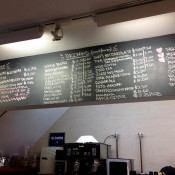 Coffee station and menu board at Dominique Ansel Bakery. Photo by alphcityguides.