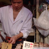 Food stall at Tsukiji Market in Tokyo. Photo by alphacityguides.