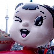 Noodle girl in Toronto's Chinatown. Photo by alphacityguides.