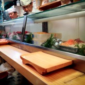 Counter seats at Daiwa Sushi in Tokyo. Photo by alphacityguides.