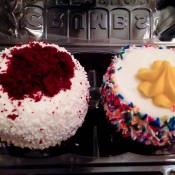 Red velvet and birthday cake cupcakes at Crumbs Bake Shop. Photo by alphaciityguides.