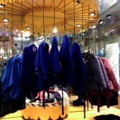 Coats on a carousel at Monki in London. Photo by alphacityguides.