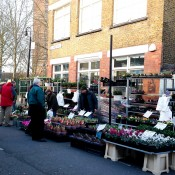 Flower vendors at Columbia Road Flower Market in London. Photo by alphacityguides.