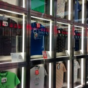 Designer t-shirt wall inside Uniqlo in Tokyo. Photo by alphacityguides.