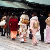 Members of a wedding procession at the Meiji Shrine in Tokyo. Photo by alphacityguides.