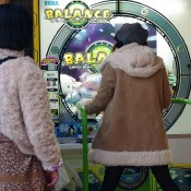 Kids playing video games in Akihabara, Tokyo. Photo by alphacityguides.